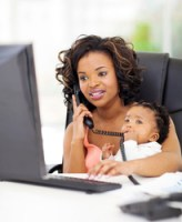 successful young african american businesswoman with baby at office