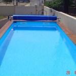 Enrouleur de bache a bulles adapte sur couloir de nage