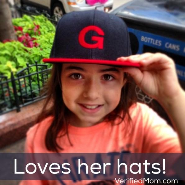 Little girl loves her baseball hats
