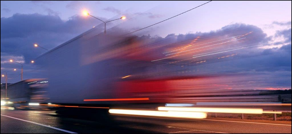Blurred trucks on a highway
