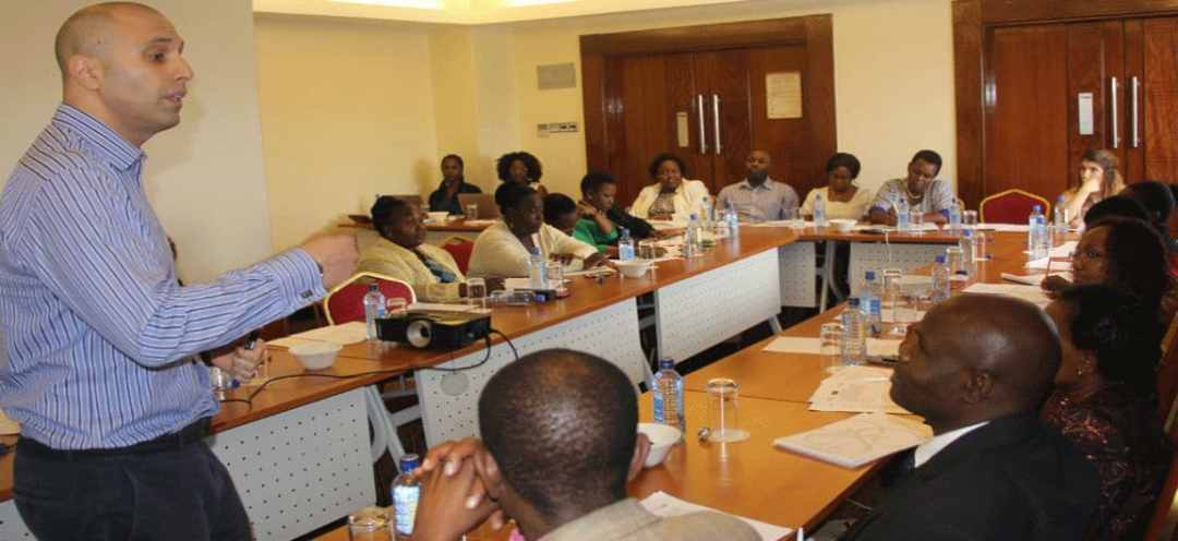 Facilitator and Attendees of a Workshop Training