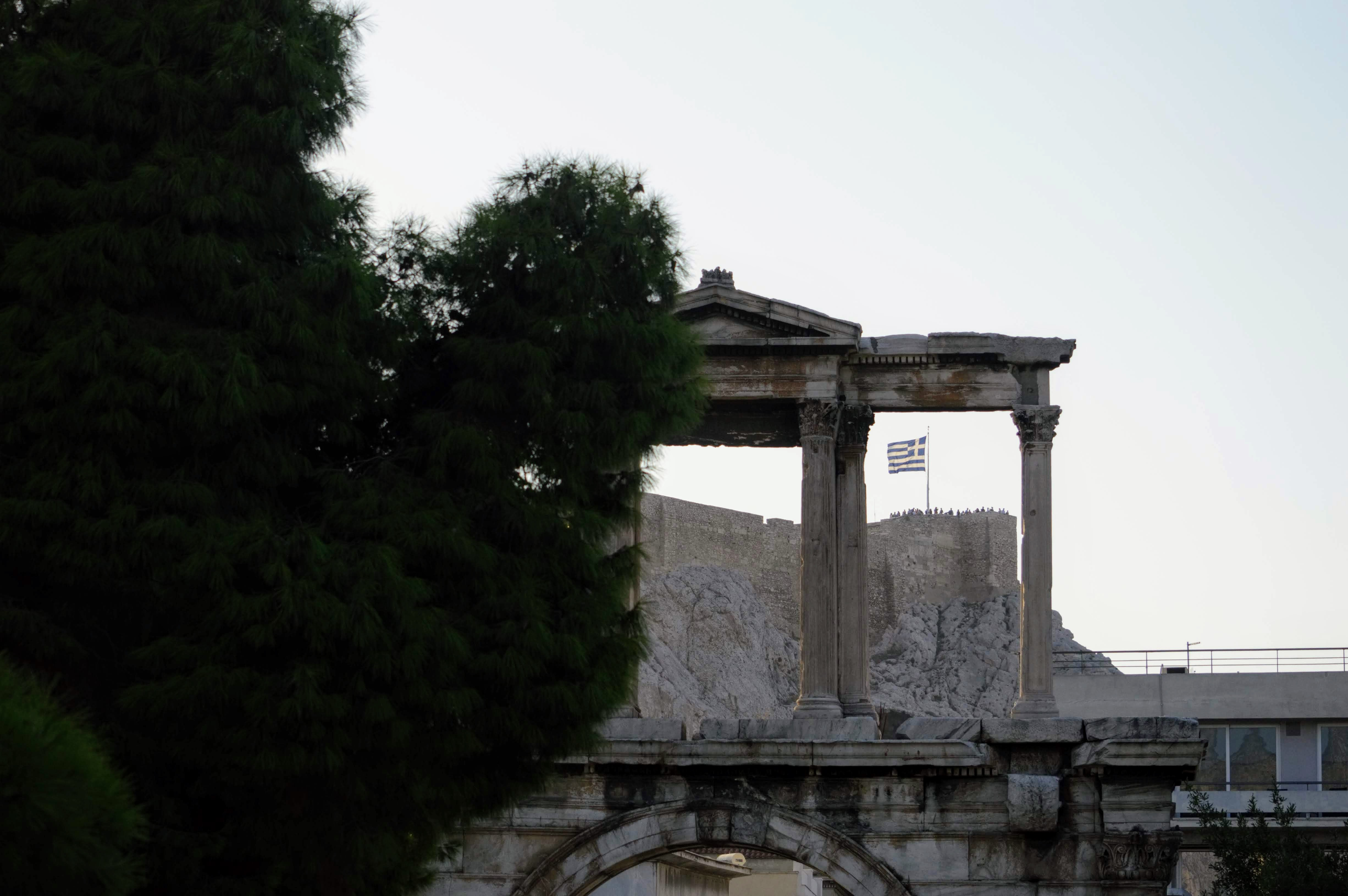 Hadrian's Arch - Athens, Greece, Europe - Honeymoon Part 1 - Athens is a beautiful capital city rich with history. With it's impressive Acropolis and quaint pedestrian streets, we headed here for our Honeymoon Part 1! Veritru Travel Blog