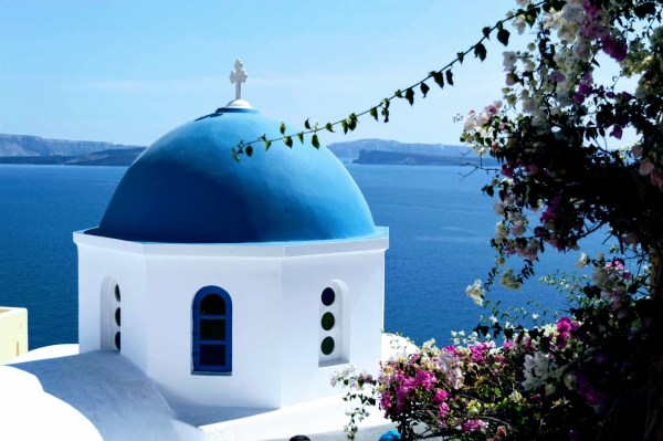 Famous Oia Blue Domes - Honeymoon Part 2 - Oia in Santorini Greece is beautiful with its pretty caldera view, sunsets, windmills and quaint pedestrian streets, we headed here for our Honeymoon Part 2! - Greek Island, Europe - Veritru