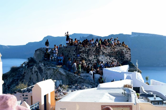 Oia sunset queue on the castle - Santorini, Greece - Honeymoon Part 2 - Oia in Santorini Greece is beautiful with its pretty caldera view, sunsets, windmills and quaint pedestrian streets, we headed here for our Honeymoon Part 2! - Greek Island, Europe - Veritru