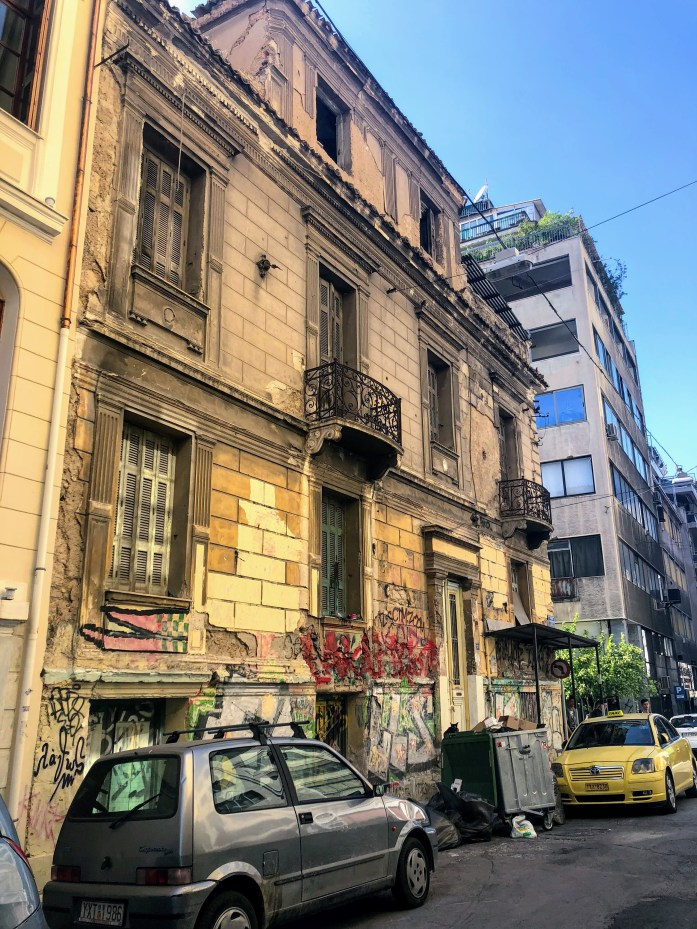 Abandoned Building, Streets, Shops and Street Art Psyri - Athens, Greece, Europe - Honeymoon Part 1 - Athens is a beautiful capital city rich with history. With it's impressive Acropolis and quaint pedestrian streets, we headed here for our Honeymoon Part 1! Veritru Travel Blog