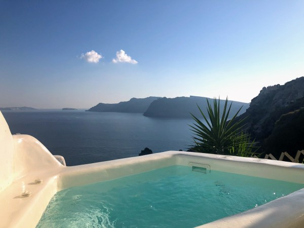 Liakada Oia Suites hot tub balcony view - Honeymoon Part 2 - Oia in Santorini Greece is beautiful with its pretty caldera view, sunsets, windmills and quaint pedestrian streets, we headed here for our Honeymoon Part 2! - Greek Island, Europe - Veritru
