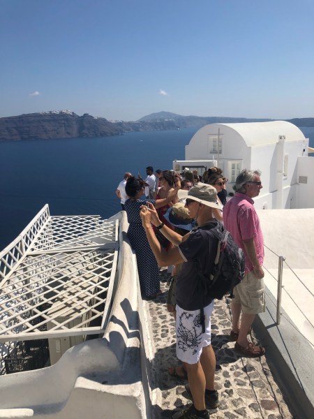Queue for the Famous Oia Three Domes Church - Honeymoon Part 2 - Oia in Santorini Greece is beautiful with its pretty caldera view, sunsets, windmills and quaint pedestrian streets, we headed here for our Honeymoon Part 2! - Greek Island, Europe - Veritru