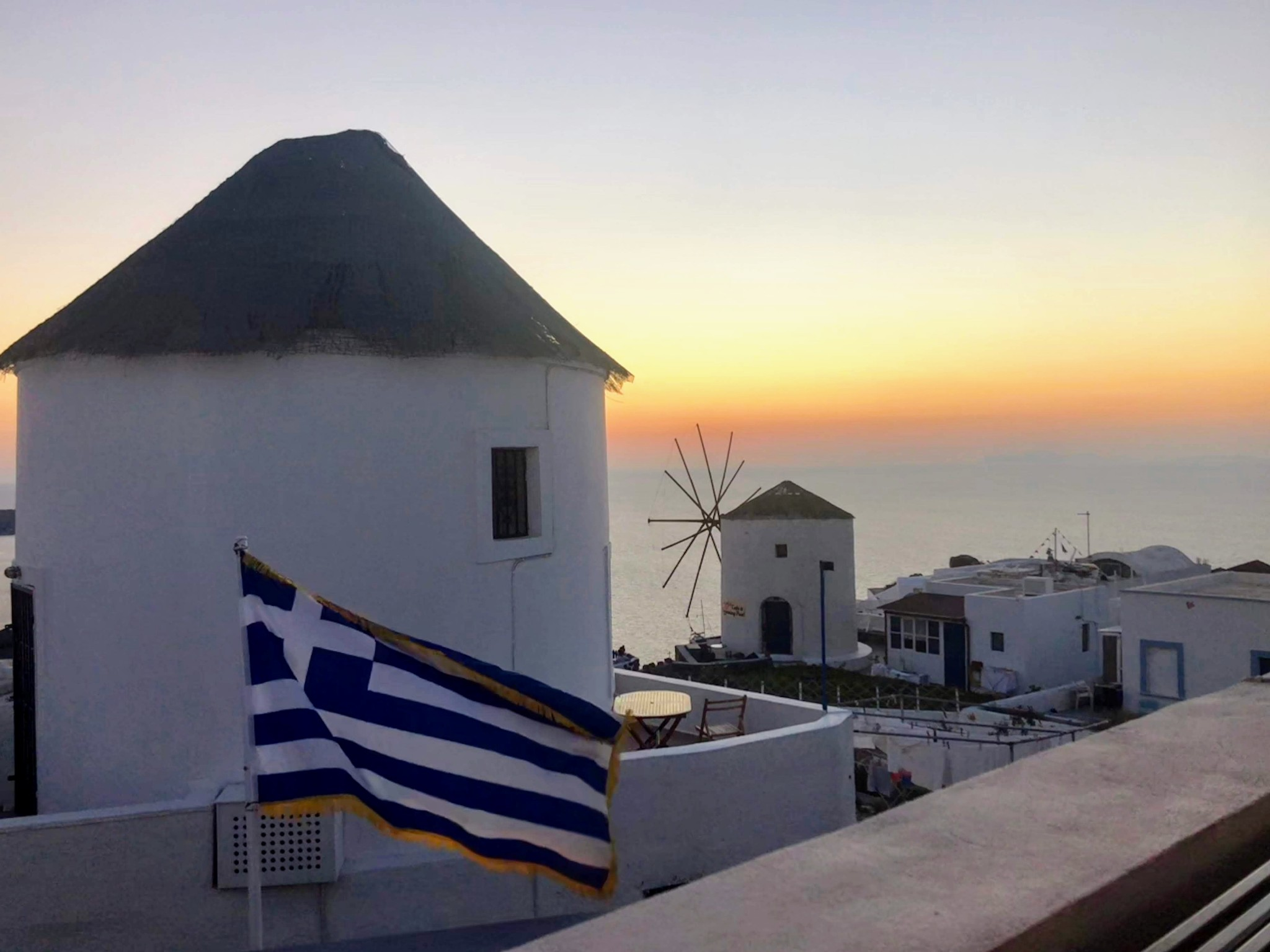 Elinikon Restaurant View Famous Oia Windmill during the sunset - Honeymoon Part 2 - Oia in Santorini Greece is beautiful with its pretty caldera view, sunsets, windmills and quaint pedestrian streets, we headed here for our Honeymoon Part 2! - Greek Island, Europe - Veritru