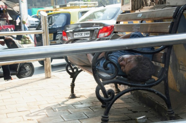 India Man sleeping on bench - Veritru - Mumbai, India