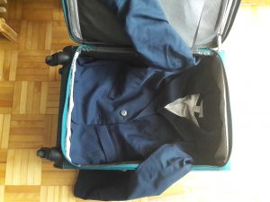 Conference travel with a carry-no: place jacket on bottom
