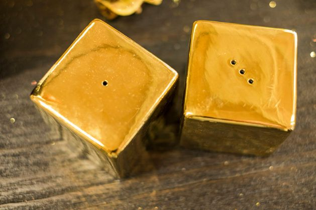 Adding a little glam with these 24ct gold salt and pepper shakers is just decadent.