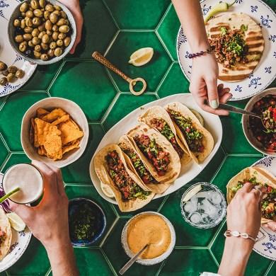 Home taco party with tortillas, tomato salsa