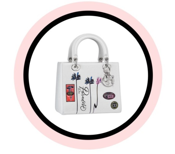 Lady Dior bag in white 'Paradise' calfskin, badges and flowers in embossed leather with a large strap.