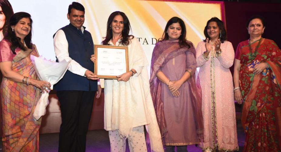 (From left) Radhika Nath, Devendra Fadnavis, Anita Dongre, Poonam Mahajan, Kaushika Hemdev and Kalpana Shah