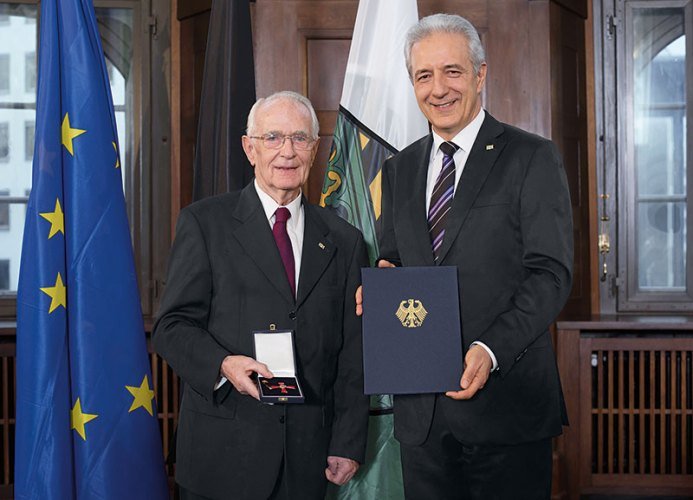 Walter Lange (left) receives the Order of Merit of the Federal Republic of Germany
