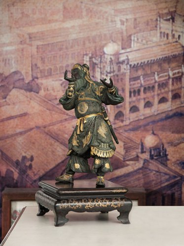 The surface encrustations on this Japanese bronze incense burner from the late 19th century were cleaned to reveal the gilded motifs