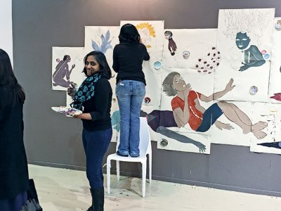 Artists Chitra Ganesh and Dhruvi Acharya painting live during the India Art Fair