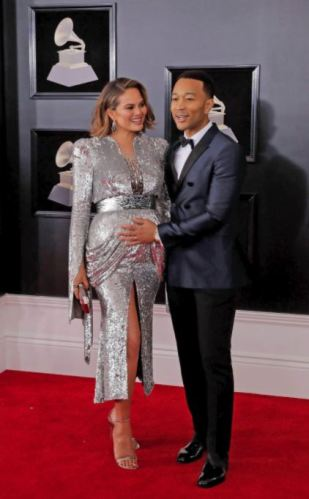 Chrissy Teigen in Yanina Couture and John Legend in Burberry