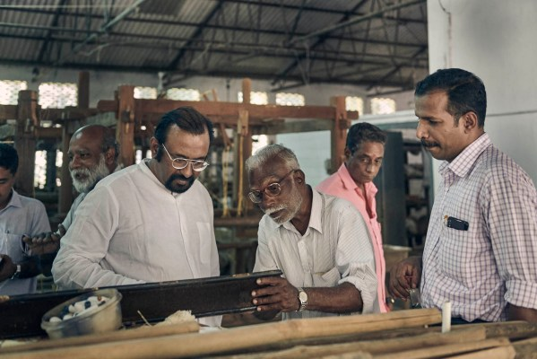 Ramesh Menon inspecting the weaving units