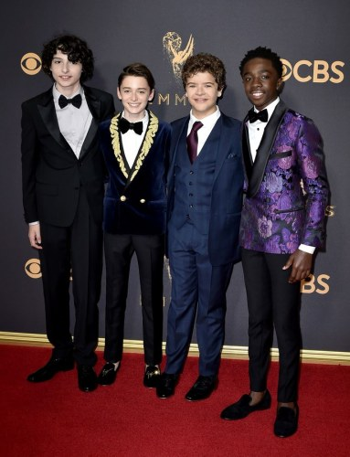 Finn Wolfhard in Prada, Noah Schnapp in Balmain, Gaten Matarazzo in Ted baker London and Caleb McLaughlin