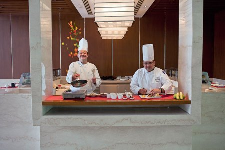 Sichuan Masterchef Tang Xi Bing (l) and Senior Sous Chef Anupam Gulati: tossing flavours