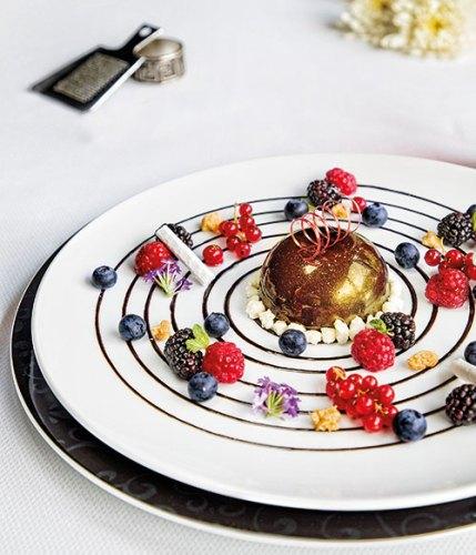 Green tea and rabri-centred chocolate parfait, fresh berries and meringue sticks