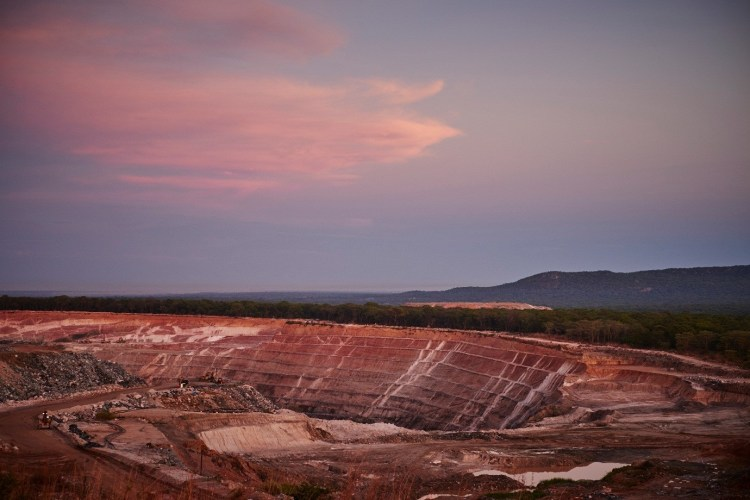Gemfields Kagem emerald mine: Open pit mine back wall highlighting pegmatites