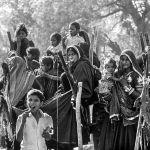 Children enjoying ice creams at a spring time fair in Rajasthan, 1986, Sudhir Kasliwal, photography