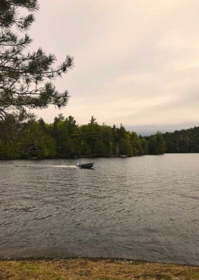 A private boat pick up from breakfast at one of the many islands scattered around lake Saranac