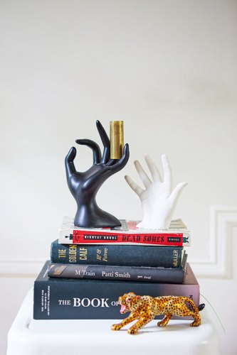 Books and Artefacts on the mantelpiece of Kavi and David's house (The plaster cast is of their daughter's hand, the leopard was bought in Kerala)