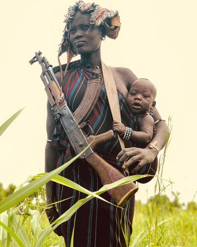 A Young Mursi Mother and a Child