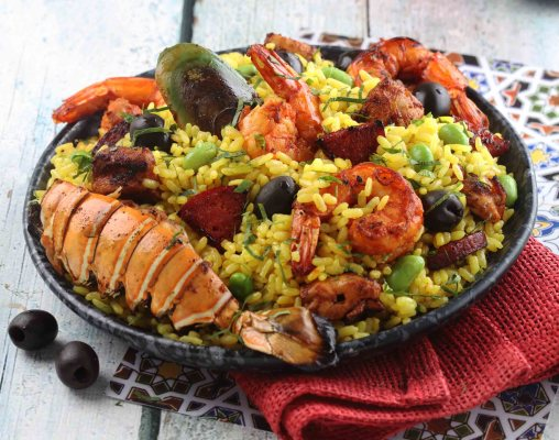 Paella valencia with lobster, prawns, chorizo and chicken