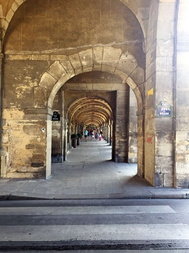 Archways in the oldest planned square in Paris