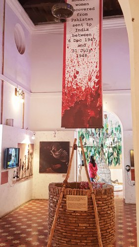 The interior of the museum with the well of remembrance and the tree of hope