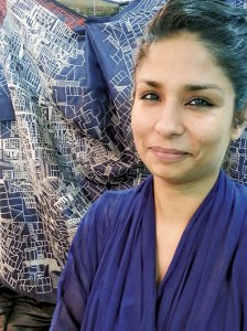 Swati Kalsi with one of her exquisite hand- created garments