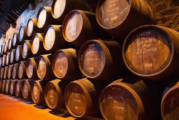 Wooden barrels holding Port fortified wine
