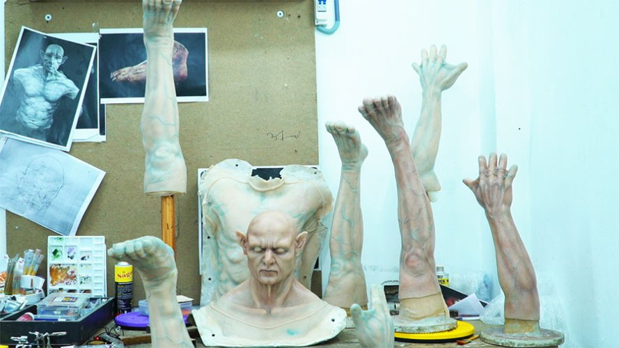 Prosthetic appliances and parts in the process of being painted