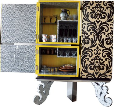 Art nouveau elements: chandelier, brocade cushions, wood-inlaid cabinet