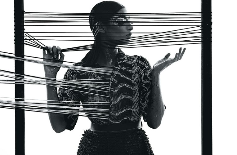 Leather cord dress with 'mat' weave and loop textures, by Rimzim Dadu. Belt, stylist's own.