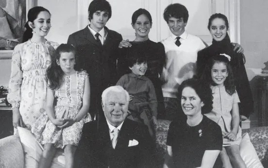 Charlie Chaplin and Oona O'Neill with their eight children