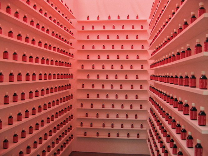 Shilpa Gupta, Blame, 2002-2004, interactive installation with Blame bottles which contain simulated blood, posters, stickers, video; interactive performance