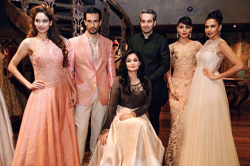 Shyamal and Bhumika Shodhan with the models