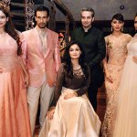 Shyamal and Bhumika Shodhan with the models
