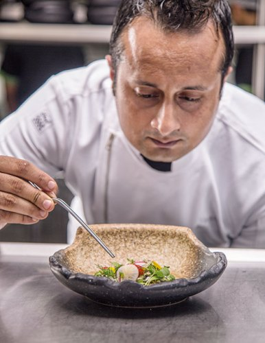 Chef Vikramjit Roy putting the finishing touches on a salad at POH, Mumbai