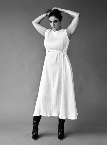 Cotton dress, from Oshadi; leather boots, from Fendi.