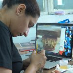 Zuby Johal painting the prosthetic teeth for a character in Ghost Stories