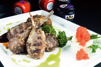 Barolo braised lamb chops in yoghurt gravy, with potato cutlets, kwark and keta caviar