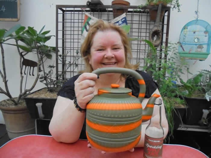 Magda Szubanski pours some tea for Parmesh