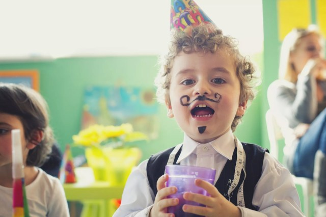 Portrait of a small boy on a birthday party
