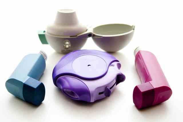 Multiple colored inhalers on white